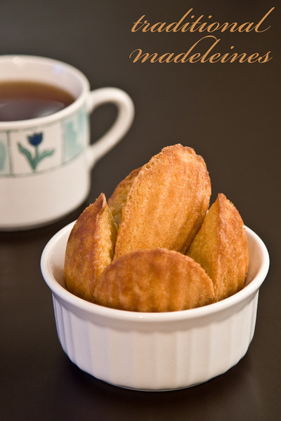traditional madeleines with tea in background