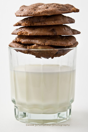 cookies on top of glass of milk