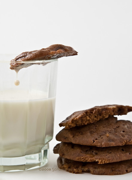 cookies and milk with drop of milk in midair