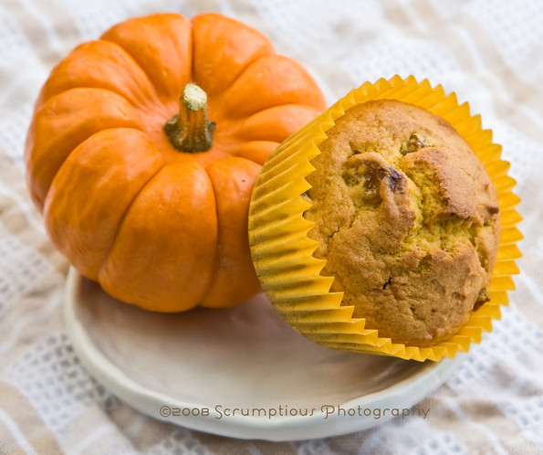 pumpkin with muffin balanced on it