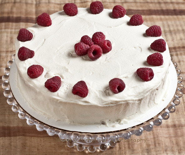 entire cake with raspberries on top